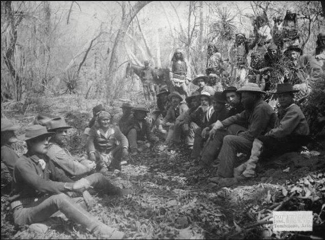 Council between General Crook and Geronimo in Mexico in March, 1886. Lt. Faison is seated far left in foreground.